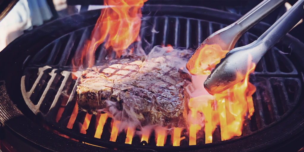 Photo of juicy steak being grilled, full of protein