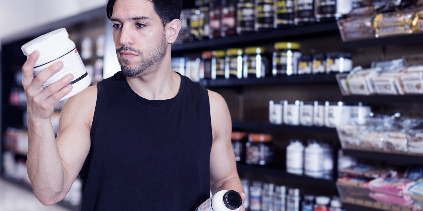 Man comparing supplements